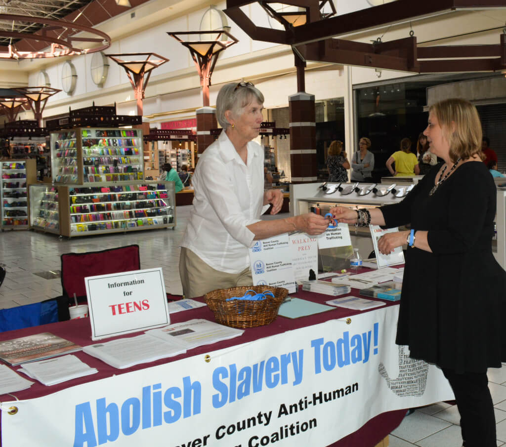 A sister staffing an anti-human trafficking booth at a trade show