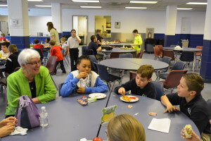 Sister Christy Hill, Principal at St. James School, connects with students at lunch time.