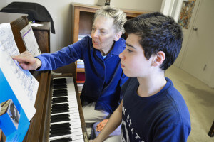 Sister Joyce Smith shares the gift of music with her students.
