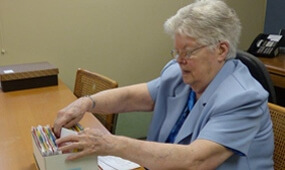 Sister Ruth working at her desk