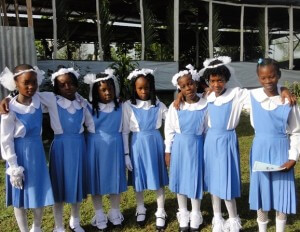 Young Haitian students, all girls, wearing pretty blue school uniforms