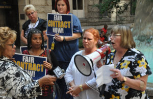 Sister Barbara Finch speaks at a rally.