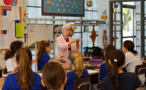 Sister Jean Stoltz teaches in a classroom.