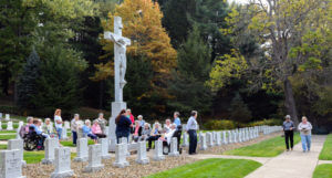 Sisters pray in the cemetery