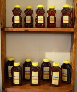 Honey bottles on shelves