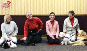 Associate Jen Heid and and her dog, Jordi; Sister Sandy Yost and her dog, Rabbie; Sister Sharon Costello and her dog, Buster; Sister Pat Montini and her dog, Luca
