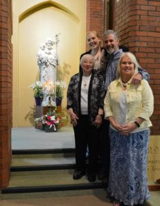 Sister Stella Cronauer with new Associate Molly Durbin and her parents, Kevin and Pamela Durbin