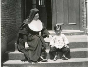 Sister Mary Mark Mullen with a young child