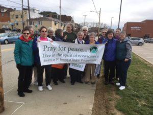 Sisters at community vigil in Ambridge, PA