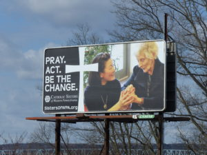 Pray. Act. Be the change. Billboard for Catholic Sisters of Western PA
