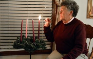 Sister Sue Clay lights first Advent candle